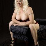 sexy blonde cougar veronica vaughn sitting and smile
